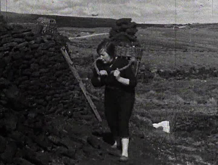 Girl collecting peat on the Western Isles