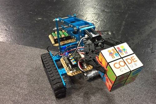 A mini robot advertising our free Code Clubs which take place in libraries throughout Scotland.