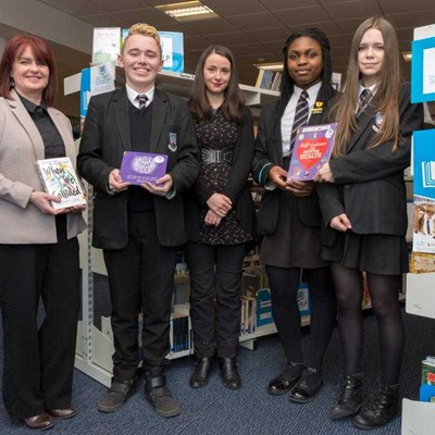 Pupils from East Dunbartonshire with the Shelf Help Book they helped to publish.